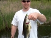 Male Bass on a Frog